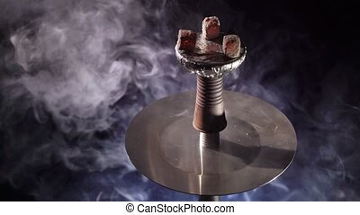 Hookah bowl with coals and smoke