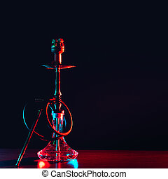 hookah shisha with coals on the table on a black background