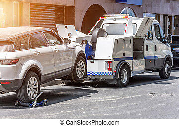 Hooked up car on a tow truck on a roadside. - Hooked up car ...