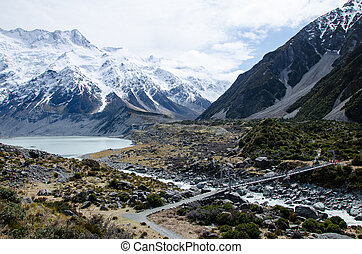 Hooker river and Mueller lake with snow covered mountains on Hooker Valley Track, South Island, New Zealand.