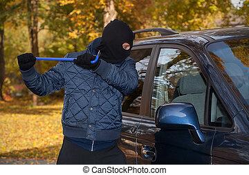 Hooligan crashing the car's window - Hooligan trying to...