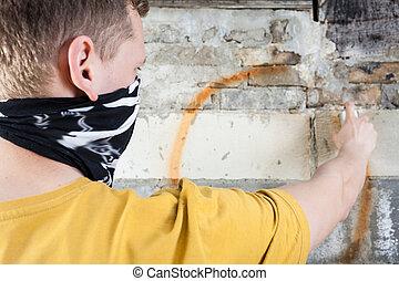 Hooligan painting graffiti