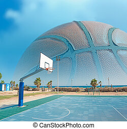 hoop by the sea with a huge basketball in the background