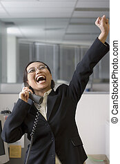 Hooraayy - Excited businesswoman in her office