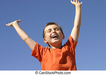 Hooray - A boy shows joy, success praise or triumph
