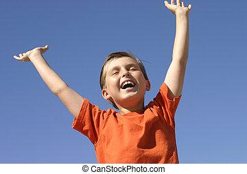 Hooray - A boy shows joy, success praise or triumph