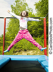 Hooray Trampoline Girl Jump - Happy girl jumping high on a...