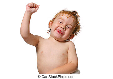 Hooray - Young boy smiling a holding his fist in the air