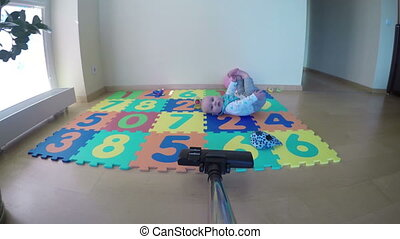 hoover baby playmat room - person clean with vacuum cleaner...