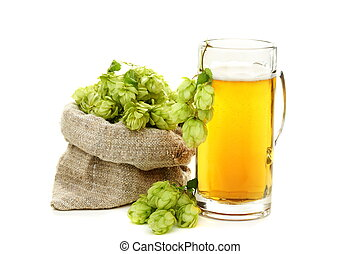 Hop cones and glass of beer. - Hop cones and glass of beer...