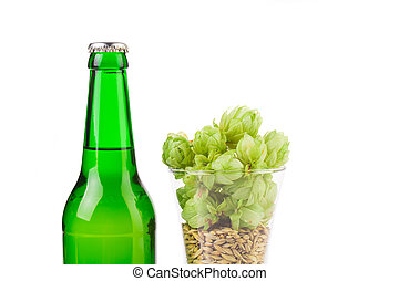 Hop in glass and a bottle of beer - A glass of hop with a...