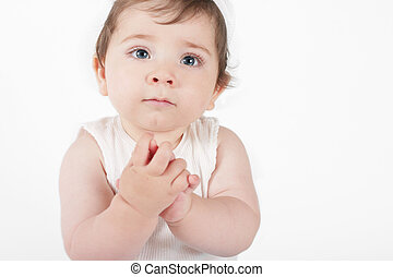 Hope and Innocence - Nine month old baby with hands clasped...
