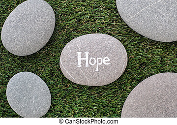 Hope. Bunch of stones lying on green grass