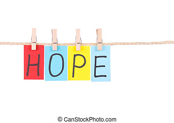 Hope, Colorful words hang on rope by wooden peg