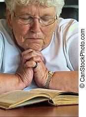 hope - Grandmother holding her hands in prayer.