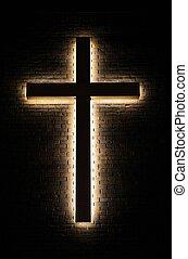 Hope - Illuminated cross on a brick wall background.
