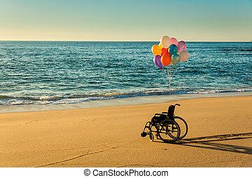 Hope is everywhere - Wellchair on a beach with colored ...