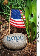 Hope message, stone and USA flag