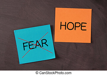 Hope concept sticky notes pasted on blackboard.