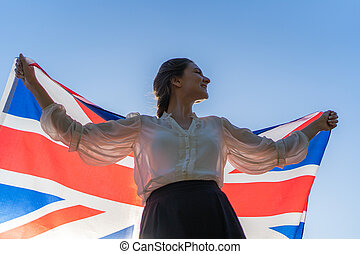 Hope to get out of lockdown. British young female student with national flag