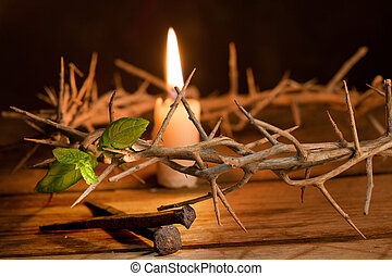 Candle burning in a crown of thorns at Easter