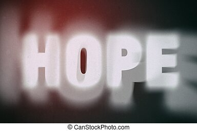 Hope word on vintage blurred background