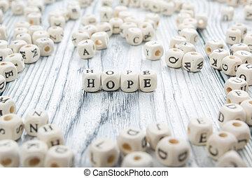 Hope word written on wood block. Wooden ABC.