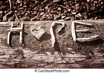 Hope - Words that spell hope are made out of sticks and...