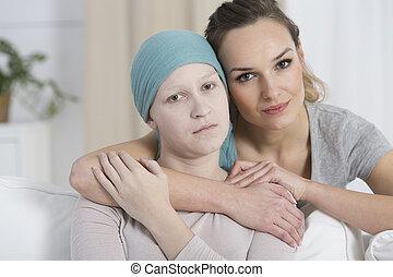 Hopeful woman hugging sad girl