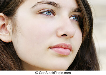 Hopeful young woman looking away - Portrait of s beautiful ...