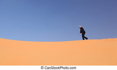 hopeless businessman in desert.mov - businessman climbing...