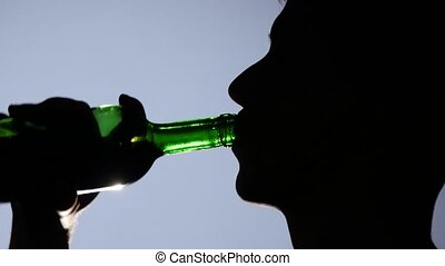 Hopeless young man drinking alcohol, drunk man drinking wine, young man depressed and drinking alcohol, sad, burnt out, stressed young man resorting to alcohol to forget his problems, close up