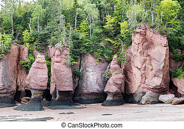 The unusual rock formations at Hopewell Rocks, Bay of Fundy, New Brunswick. The extreme tidal range of the bay makes them only accessible at low tide.