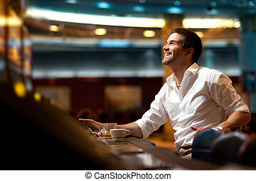 hoping to win casino player - smiling handsome man hoping to...