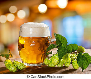 hops and beer glass - still life with glass of beer and hops