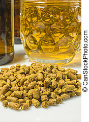 Hops pellets with beer glass