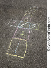 Hopscotch board - Colorful chalk hopscotch board in the...