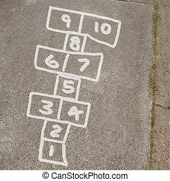 Hopscotch Game in Chalk on Sidewalk - Kids game of hopscotch...