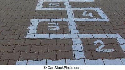 hopscotch game scheme, drawn on stone paving