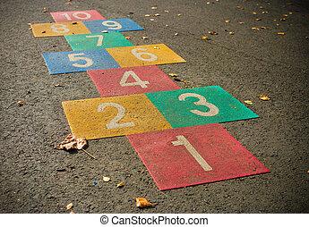 hopscotch game - colorful hopscotch game on a schoolyard