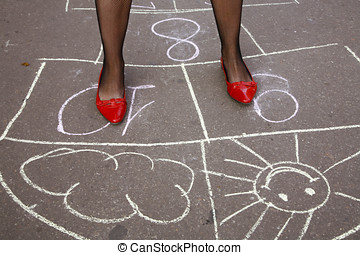 Hopscotch: variant - Legs of young woman jumping hopscotch