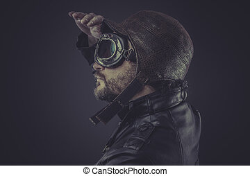 horizon, pilot dressed in vintage style leather cap and goggles