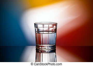 abstract image glass of water on multicolored background