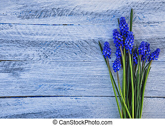 Horizontal background with a bouquet of blue flowers