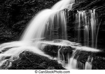 Horizontal black and white image of Onondaga Falls, in Glen Leigh at Ricketts Glen State Park, Pennsylvania.
