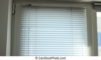 Horizontal Blinds Rise - Window blinds are rised to allow...