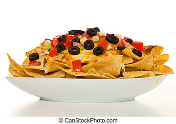 Horizontal cheese nachos - Nachos with vegetable on the top....