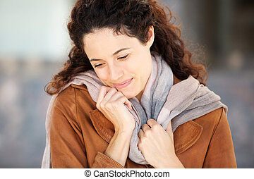 Horizontal close up beautiful young woman smiling with coat and scarf