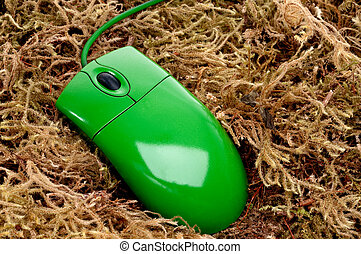 horizontal close up of a green computer mouse on moss