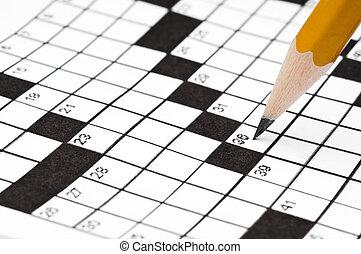 Horizontal close up of a sharp pencil on a crossword puzze